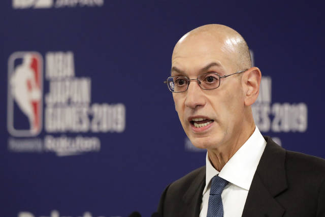 FILE - In this Oct. 8, 2019, file photo, NBA Commissioner Adam Silver speaks at a news conference before an NBA preseason basketball game between the Houston Rockets and the Toronto Raptors in Saitama, Japan. Silver is giving preseason state-of-the-league remarks Monday, Dec. 21, 2020, before opening night Tuesday, talking about how the league will handle the ongoing pandemic and the continued focus on social issues such as racial injustice. (AP Photo/Jae C. Hong, File)