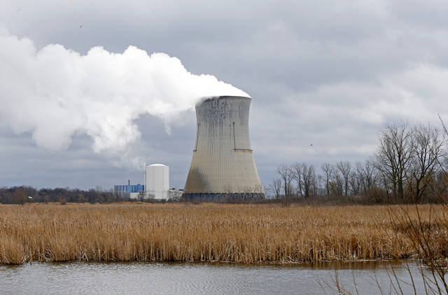 FILE - This April 4, 2017 file photo shows the then-FirstEnergy Corp.'s Davis-Besse Nuclear Power Station in Oak Harbor, Ohio. The fate of the legislation that aimed to bailout Ohio's two nuclear plants remains unclear as the Legislature meets for a final session Tuesday, Dec. 22, 2020, to discuss any potential bill that would remedy, delay or repeal portions of the legislation. (AP Photo/Ron Schwane, File)