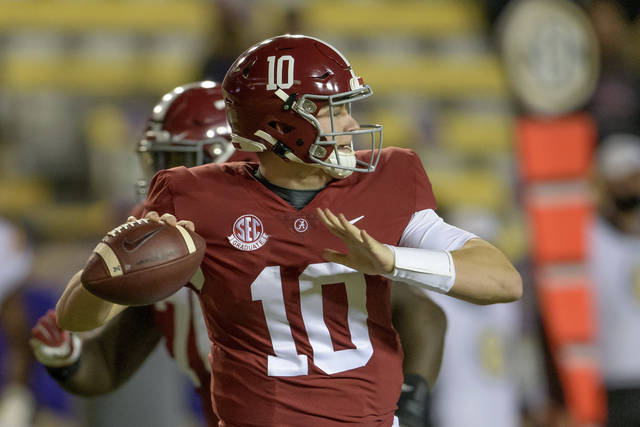 FILE - In this Dec. 5, 2020, file photo, Alabama quarterback Mac Jones (10) throws during the first half of an NCAA college football game against LSU in Baton Rouge, La. (AP Photo/Matthew Hinton, File)