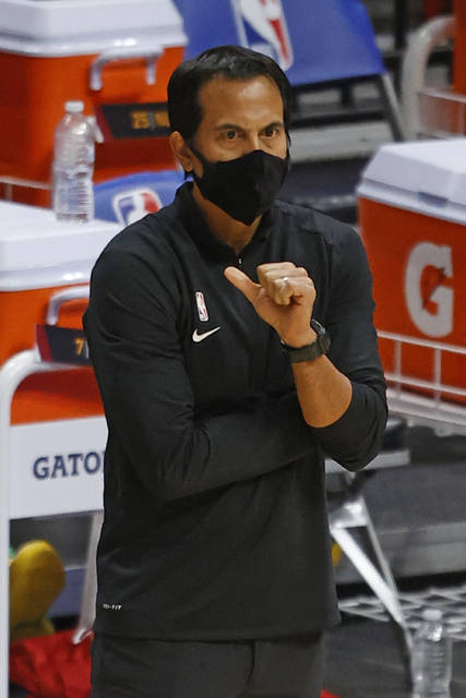 Miami Heat head coach Erik Spoelstra watches during the fourth quarter of an NBA basketball game against the New Orleans Pelicans, Friday, Dec. 25, 2020, in Miami. (AP Photo/Joel Auerbach)