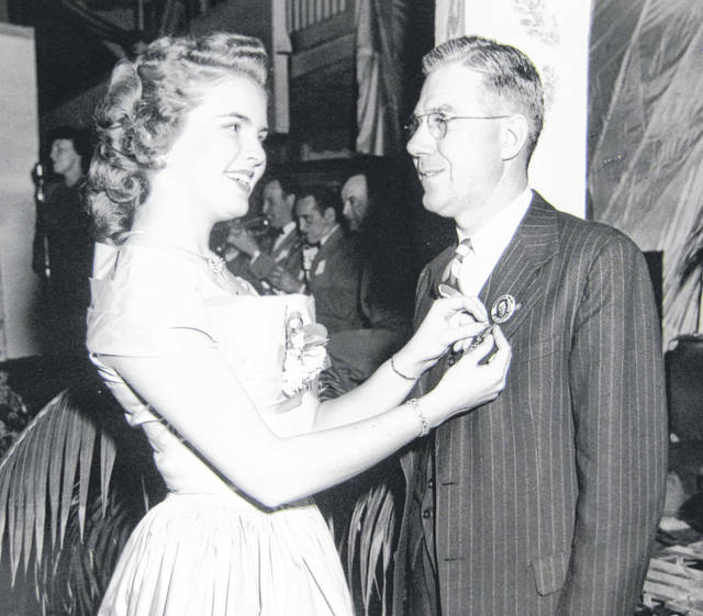 At the Clinton County Junior-Senior Dance in April, 1949, Miss Beatrice Shopp, who was Miss America of 1948, pins Carl Shanks Sr. Can you tell us more? Share it at info@wnewsj.com. The photo, which was taken by Robert McNemar, is courtesy of the Clinton County Historical Society. Like this image? Reproduction copies of this photo are available by calling the History Center. For more info, visit www.clintoncountyhistory.org; follow them on Facebook @ClintonCountyHistory; or call 937-382-4684.