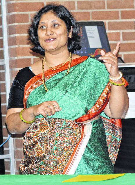 Wilmington College Biology Professor Savitha Krishna will share insight into the tradition of Dawali at the Winter Holiday Celebration. She is pictured giving a presentation at an International Club program in 2015.