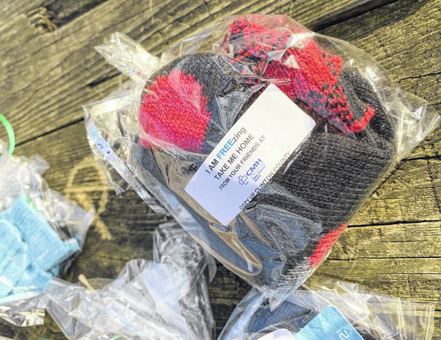 The staff assembled packages of hats and gloves available for free all around the county.