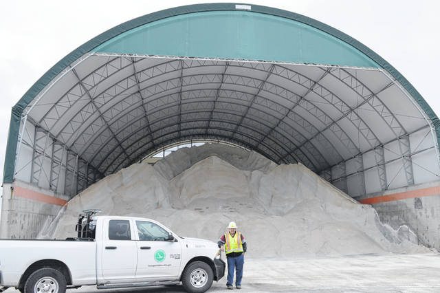 Ohio Department of Transportation (ODOT) Clinton County Manager Michael Lovelace stands in front of road salt stored for use this winter to help clear local roadways for vehicle traffic when needed. ODOT's first priority routes are the Interstate first and then the main arteries into the city.