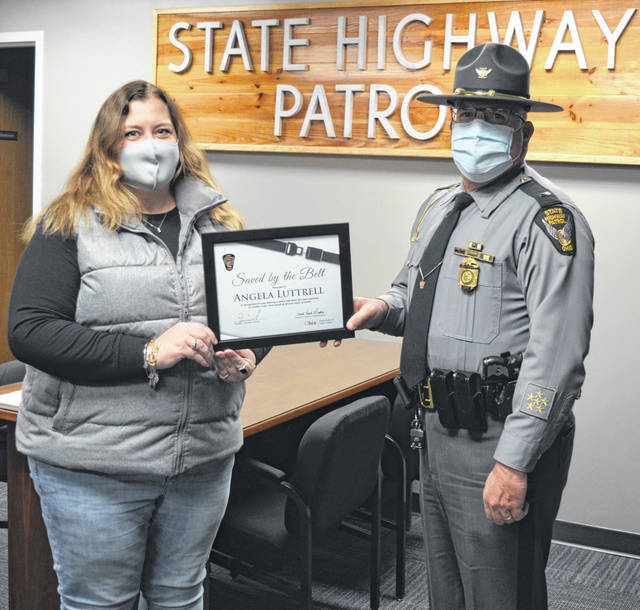 "From left, Angela Luttrell of Clinton County is presented a ""Saved by the Belt"" certificate from Wilmington Post Commander and Lieutenant Stanley A. Jordan."