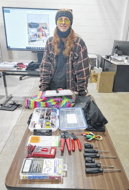 Laurel Oaks student Malachi Lowe of Lynchburg with items from the tool kits.
