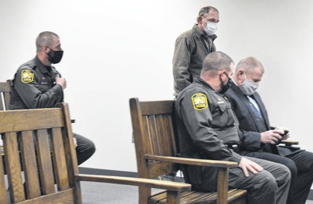 As staff with the Ohio Department of Natural Resources sit in the courtroom gallery, Brian R. Liming of Jamestown walks toward the defendant's table to take his seat.