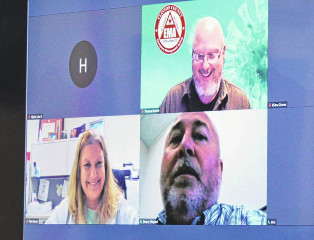 Clockwise from upper right at Monday's virtual meeting with county commissioners are Clinton County EMA Director Thomas Breckel, Duane Weyand who is county information officer, and Clinton County Health Commissioner Pam Bauer.