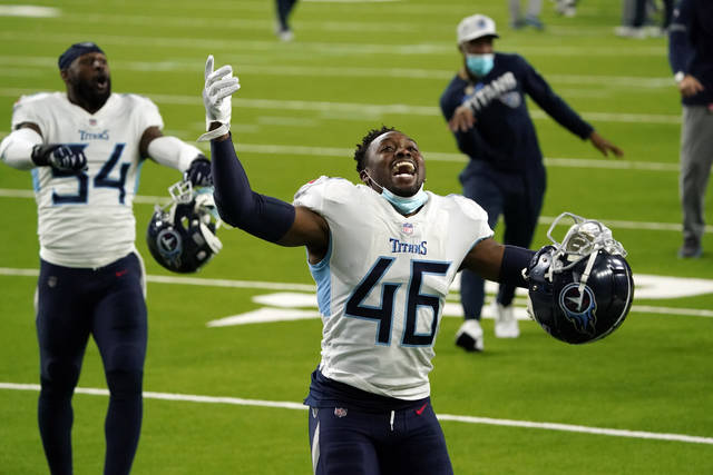 Tennessee Titans' Joshua Kalu (46) celebrates after an NFL football game against the Houston Texans Sunday, Jan. 3, 2021, in Houston. The Titans won 41-38. (AP Photo/Sam Craft)