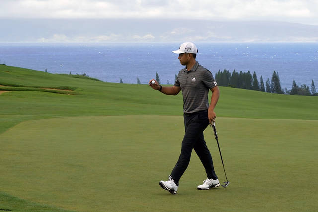 FILE - Xander Schauffele acknowledges the gallery after putting on the fourth green during the third round of the Tournament of Champions golf event at Kapalua Plantation Course in Kapalua, Hawaii, in this Saturday, Jan. 4, 2020, file photo. Schauffele is among 16 players in the Tournament of Champions who didn't win last year. (AP Photo/Matt York, File)
