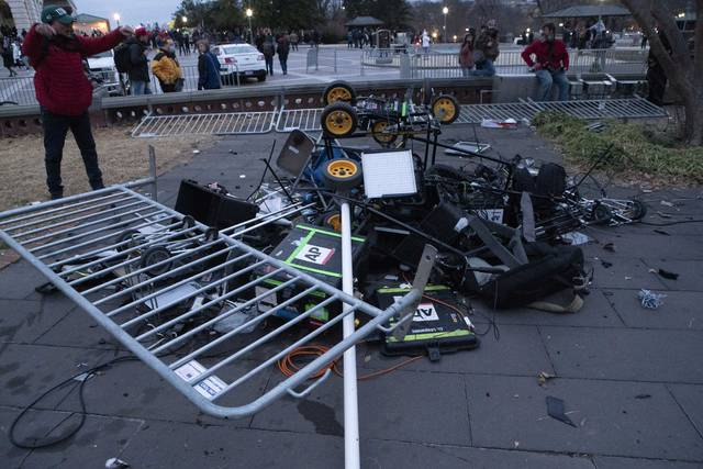 Demonstrators left a pile of broken TV equipment outside the the U.S. Capitol on Wednesday, Jan. 6, 2021, in Washington. (AP Photo/Jose Luis Magana)