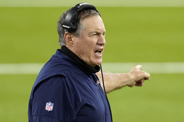 FILE - In this Thursday, Dec. 10, 2020, file photo, New England Patriots head coach Bill Belichick yells from the sideline during the second half of an NFL football game against the Los Angeles Rams in Inglewood, Calif. President Donald Trump will present one of the nation's highest civilian honors to Bill Belichick, the football coach of the New England Patriots and the only coach to win six Super Bowl titles. The presentation of the Presidential Medal of Freedom is expected Thursday, Jan. 14, 2021. (AP Photo/Ashley Landis, File)