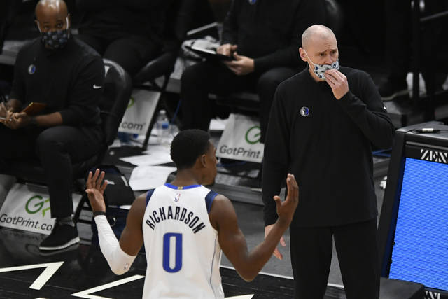 Dallas Mavericks head coach Rick Carlisle and Josh Richardson (0) argue with referees after Richardson was called for a foul during the second half of an NBA basketball game against the Chicago Bulls, Sunday, Jan. 3, 2021, in Chicago. (AP Photo/Paul Beaty)