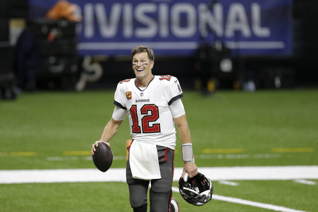 Tampa Bay Buccaneers quarterback Tom Brady leaves the field an NFL divisional round playoff football game against the New Orleans Saints, Sunday, Jan. 17, 2021, in New Orleans. The Buccaneers won 30-20. (AP Photo/Brett Duke)