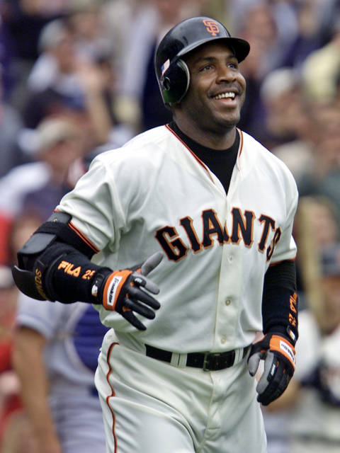FILE -  In this Oct. 7, 2001, file photo, San Francisco Giants' Barry Bonds smiles as he begins to round the bases after he hit his 73rd home run of the season, against the Los Angeles Dodgers in a baseball game in San Francisco. The baseball Hall of Fame won't have any new players in the class of 2021 after voters decided no one had the merits — on-the-field or off — for enshrinement in Cooperstown on this year's ballot. Curt Schilling, Bonds and Roger Clemens were the closest in voting by members of the Baseball Writers' Association of America released Tuesday, and the trio will have one more chance at election next year. It's the first time the BBWAA didn't choose anyone since 2013. (AP Photo/Eric Risberg, File)