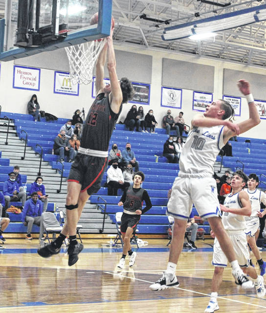 Wilmington's Brady Vilvens with one of three dunks in a 74-53 rout of Washington Senior Monday night. (Photo by Chris Hoppes/Record-Herald)