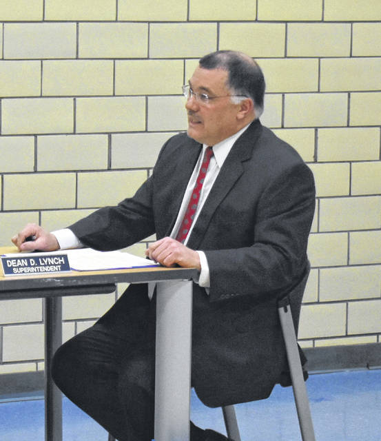 Blanchester Superintendent Dean Lynch formally submits his letter of retirement at Monday's Blanchester School Board meeting.