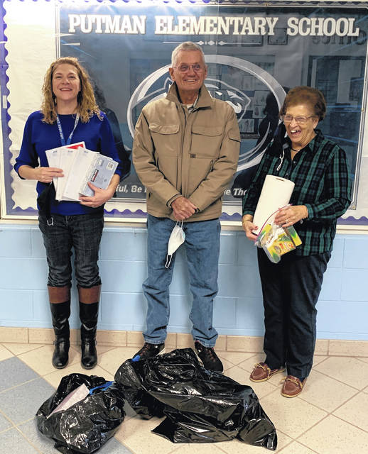 The Dems for Kids program of the Clinton County Democratic Party recently donated school supplies to county elementary schools, as they have done since 2001. Donated supplies include paper, pencils, crayons, scissors, and other items needed by young students. From left are Blanchester's Putman Elementary secretary Caryn McCarty; Don Spurling, Dems for Kids; and Putman secretary, Linda Larrick.