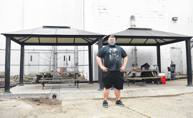 Sugartree Ministries Director Lee Sandlin stands in front of the relocated gazebos at Sugartree Ministries. The new spot is less visible from Main Street in Wilmington.