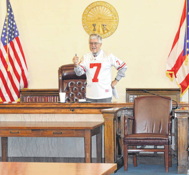 "On Friday, Jan. 8 Clinton County Common Pleas Judge John W. ""Tim"" Rudduck came out from judge's chambers wearing an Ohio State University Buckeyes jersey to begin the twice-monthly drug court status hearings. The judge explained he is a Buckeyes fan and noted that OSU plays Monday evening in the college football national championship game. While chatting with drug court participants and their supporters before the proceedings began, it was learned the wife of one of the participants is a Michigan fan, which the judge had some fun with. The light-hearted start to the session contrasted with a somber close when a recent upsurge in local drug overdoses was discussed. An article on the drug court session is planned for Tuesday's edition of the Wilmington News Journal."