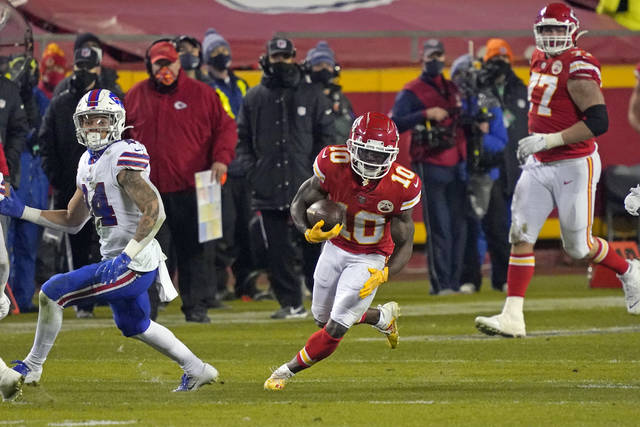 Kansas City Chiefs wide receiver Tyreek Hill (10) runs up field after catching a pass during the second half of the AFC championship NFL football game against the Buffalo Bills, Sunday, Jan. 24, 2021, in Kansas City, Mo. (AP Photo/Jeff Roberson)