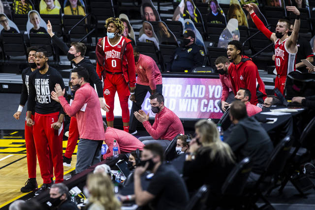 Ohio State players celebrate on the bench in the second half during an NCAA college basketball game against Iowa Thursday, Feb. 4, 2021, in Iowa City, Iowa. (Joseph Cress/Iowa City Press-Citizen via AP)