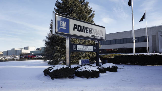 The exterior of the General Motors Toledo Transmission Operations facility is shown in Toledo, Ohio, Tuesday, Feb. 2, 2021.  When General Motors boldly announced its goal last month to make only battery-powered vehicles by 2035, it didn't just mark a break with more than a century of making internal combustion engines. It also clouded the future for 50,000 GM workers whose skills — and jobs — could become obsolete far sooner than they knew. (AP Photo/Paul Sancya)
