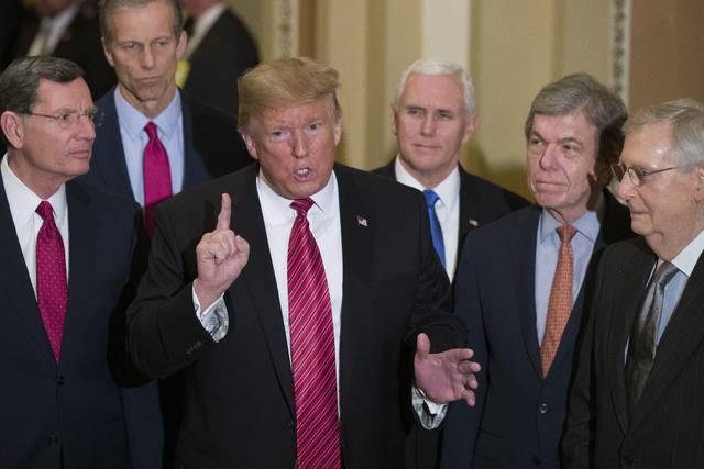 FILE - In this Wednesday, Jan. 9, 2019 file photo, Sen. John Barrasso, R-Wyo., left, and Sen. John Thune, R-S.D., stand with President Donald Trump, Vice President Mike Pence, Sen. Roy Blunt, R-Mo., and Senate Majority Leader Mitch McConnell of Ky., as Trump speaks while departing after a Senate Republican Policy luncheon, on Capitol Hill in Washington. The Republican Party still belongs to Donald Trump. The GOP privately flirted with purging the norm-shattering former president after he incited a deadly riot at the U.S. Capitol last month. But in the end, only seven of 50 Senate Republicans voted to convict Trump in his historic second impeachment trial on Saturday, Feb. 13, 2021. (AP Photo/Alex Brandon, File)