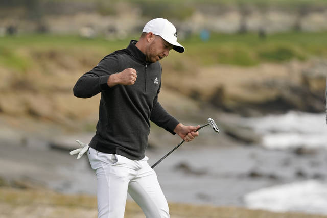 Daniel Berger reacts after making an eagle putt on the 18th green of the Pebble Beach Golf Links during the final round of the AT&T Pebble Beach Pro-Am golf tournament Sunday, Feb. 14, 2021, in Pebble Beach, Calif. Berger won the tournament. (AP Photo/Eric Risberg)