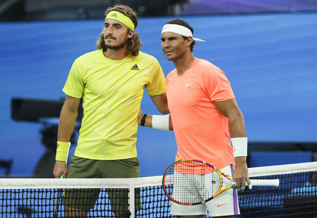 Spain's Rafael Nadal, right, and Greece's Stefanos Tsitsipas pose for a photo ahead of their quarterfinal match at the Australian Open tennis championship in Melbourne, Australia, Wednesday, Feb. 17, 2021.(AP Photo/Hamish Blair)