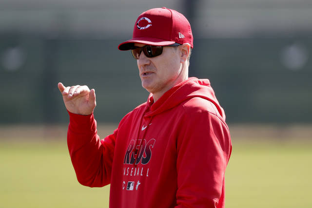 FILE - In this Saturday, Feb. 15, 2020, file photo, Cincinnati Reds manager David Bell talks during the teams' first spring training baseball workout in Goodyear, Ariz. Just when the Cincinnati Reds started to roll last year, the strange, pandemic-shortened season came to an end after 60 games. But manager David Bell saw his team developing cohesiveness and momentum down the stretch he believes can carry over into 2021. (AP Photo/Matt York, File)