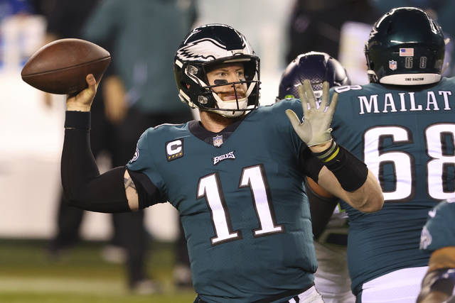 FILE - Philadelphia Eagles' Carson Wentz (11) passes during an NFL football game against the Seattle Seahawks in Philadelphia, in this Monday, Nov. 30, 2020, file photo. The Philadelphia Eagles have agreed to trade Carson Wentz to the Indianapolis Colts, according to a person familiar with the deal. The person spoke to The Associated Press on condition of anonymity because the deal hasn't been announced. (AP Photo/Rich Schultz, File)