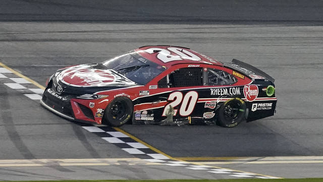 Christopher Bell crosses the finish line to win the NASCAR Cup Series road course auto race at Daytona International Speedway, Sunday, Feb. 21, 2021, in Daytona Beach, Fla. (AP Photo/John Raoux)