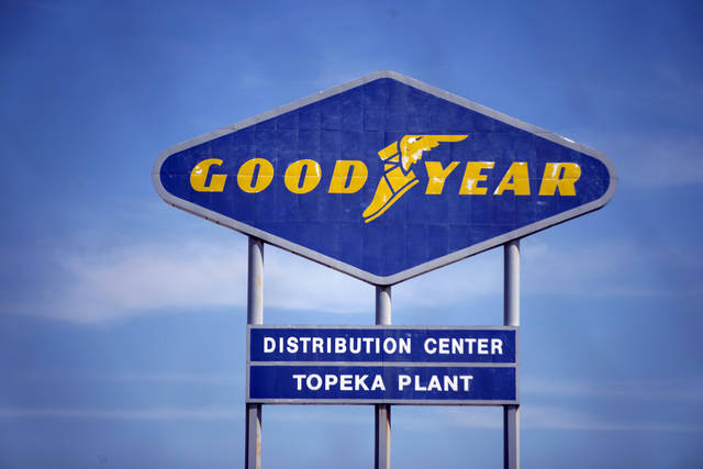 FILE - In this Aug. 20, 2020 file photo, signage for the Goodyear Distribution Center stands in Topeka, Kan. Goodyear Tire and Rubber Co. is acquiring Cooper tires in a deal valued at $2.5 billion that will combine the two century-old Ohio companies.  (Evert Nelson/The Topeka Capital-Journal via AP, File)