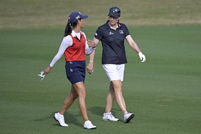 FILE - In this Sunday, Jan. 24, 2021 file photo, Celine Boutier, left, of France, and Annika Sorenstam, of Sweden, chat while walking down the 17th fairway during the final round of the Tournament of Champions LPGA golf tournament in Lake Buena Vista, Fla. Sorenstam will compete on the LPGA this week for the first time since 2008. (AP Photo/Phelan M. Ebenhack, File)
