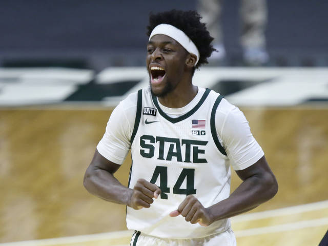 Michigan State forward Gabe Brown celebrates the team's 71-67 win over Ohio State in an NCAA college basketball game Thursday, Feb. 25, 2021, in East Lansing, Mich. (AP Photo/Duane Burleson)