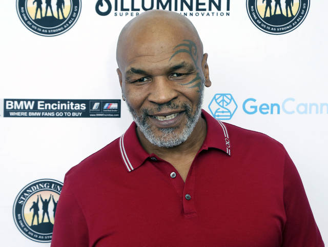 """FILE - In this Aug. 2, 2019, file photo, Mike Tyson attends a celebrity golf tournament in Dana Point, Calif. Hulu on Thursday, Feb. 25, 2021, announced it has ordered """"Iron Mike,"""" a limited series about the life of boxing great Mike Tyson. (Photo by Willy Sanjuan/Invision/AP, File)"""
