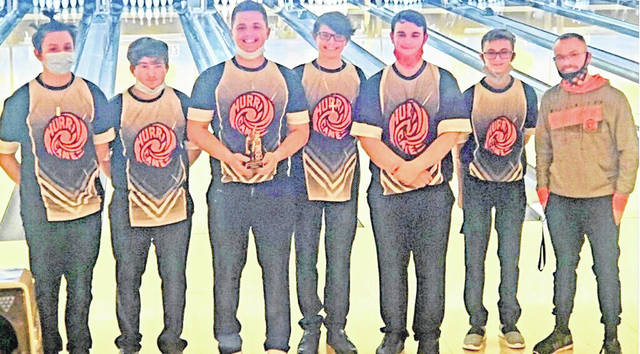 The Wilmington High School boys bowling team did not participate in the SBAAC American Division tournament because they were in quarantine for Covid-19. The team earned a share of the league title. In the photo, from left to right, Jayden Tackett, Hunter Gallion, Jordan Tackett, Lucas Neff, Isaac Martini, Isaac Pletcher and head coach Dustin Brown.