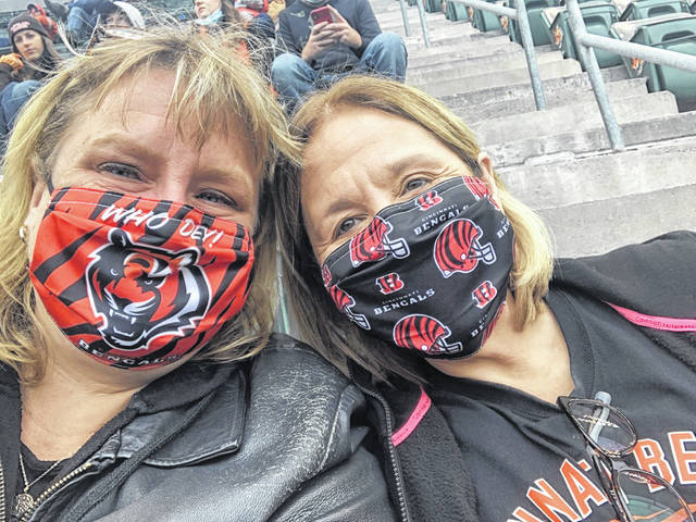 Jen Hosler, left, and her friend Krissel Moore are going to the Super Bowl.