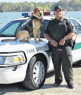 ODNR Officer Jason Lagore, who died while responding to the incident at Rocky Fork Lake, is pictured with his K-9 partner, Sarge.