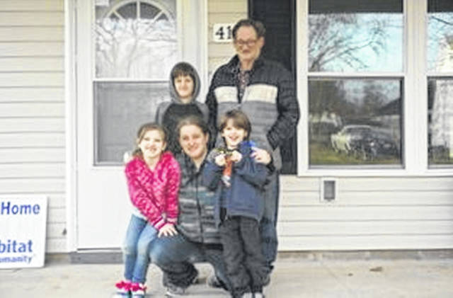 Raymond Baker, his granddaughter Keshia and her children Jacob 10, Kaydence 7, and Ryan 5 have moved into their new home.