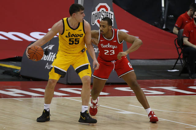 Iowa's Luka Garza, left, posts up against Ohio State's Zed Key during the first half of an NCAA college basketball game Sunday, Feb. 28, 2021, in Columbus, Ohio. (AP Photo/Jay LaPrete)