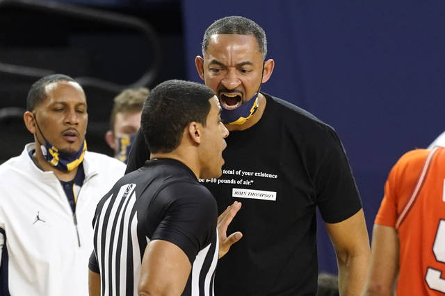 Michigan head coach Juwan Howard yells at a referee before receiving a technical foul in the second half of an NCAA college basketball game against Illinois in Ann Arbor, Mich., Tuesday, March 2, 2021. (AP Photo/Paul Sancya)