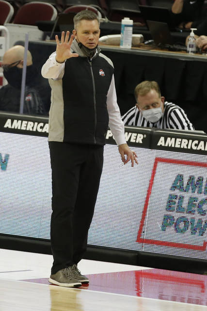 Ohio State head coach Chris Holtmann signals to his team against Iowa during the second half of an NCAA college basketball game Sunday, Feb. 28, 2021, in Columbus, Ohio. (AP Photo/Jay LaPrete)