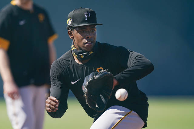 Pittsburgh Pirates' Ke'Bryan Hayes takes part in a drill during a spring training baseball workout Thursday, Feb. 25, 2021, in Bradenton, Fla. (AP Photo/Frank Franklin II)