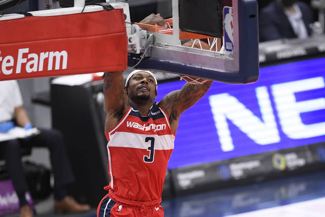 Washington Wizards guard Bradley Beal (3) goes to the basket during the first half of an NBA basketball game against the Los Angeles Clippers, Thursday, March 4, 2021, in Washington. (AP Photo/Nick Wass)