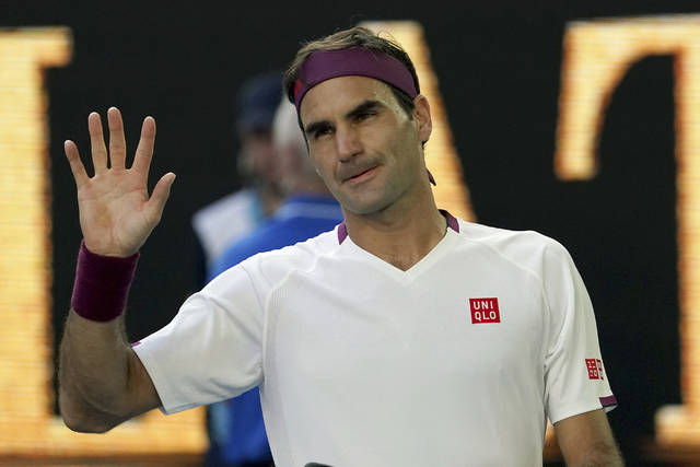 FILE- In this Jan. 28, 2020, file photo, Switzerland's Roger Federer waves after defeating Tennys Sandgren, of the United States, in their quarterfinal match at the Australian Open tennis championship in Melbourne, Australia. Federer is back on tour after more than a year away. (AP Photo/Lee Jin-man, File)