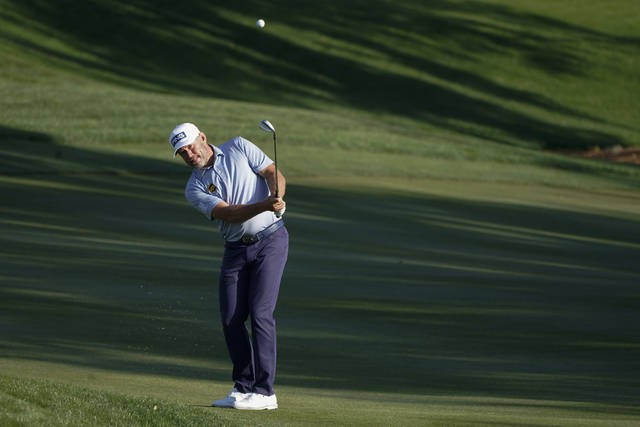 Lee Westwood, of England, chips to the green on the ninth hole during the second round of the The Players Championship golf tournament Friday, March 12, 2021, in Ponte Vedra Beach, Fla. (AP Photo/Gerald Herbert)