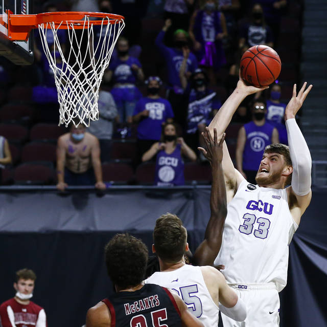 Grand Canyon's Asbjørn Midtgaard (33) shoots against New Mexico State during the first half of an NCAA college basketball game for the championship of the Western Athletic Conference men's tournament Saturday, March 13, 2021, in Las Vegas. (AP Photo/Chase Stevens)