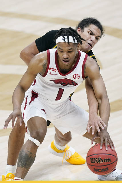 Missouri's Dru Smith, top, defends against Arkansas' JD Notae (1) in the first half of an NCAA college basketball game in the Southeastern Conference Tournament Friday, March 12, 2021, in Nashville, Tenn. (AP Photo/Mark Humphrey)